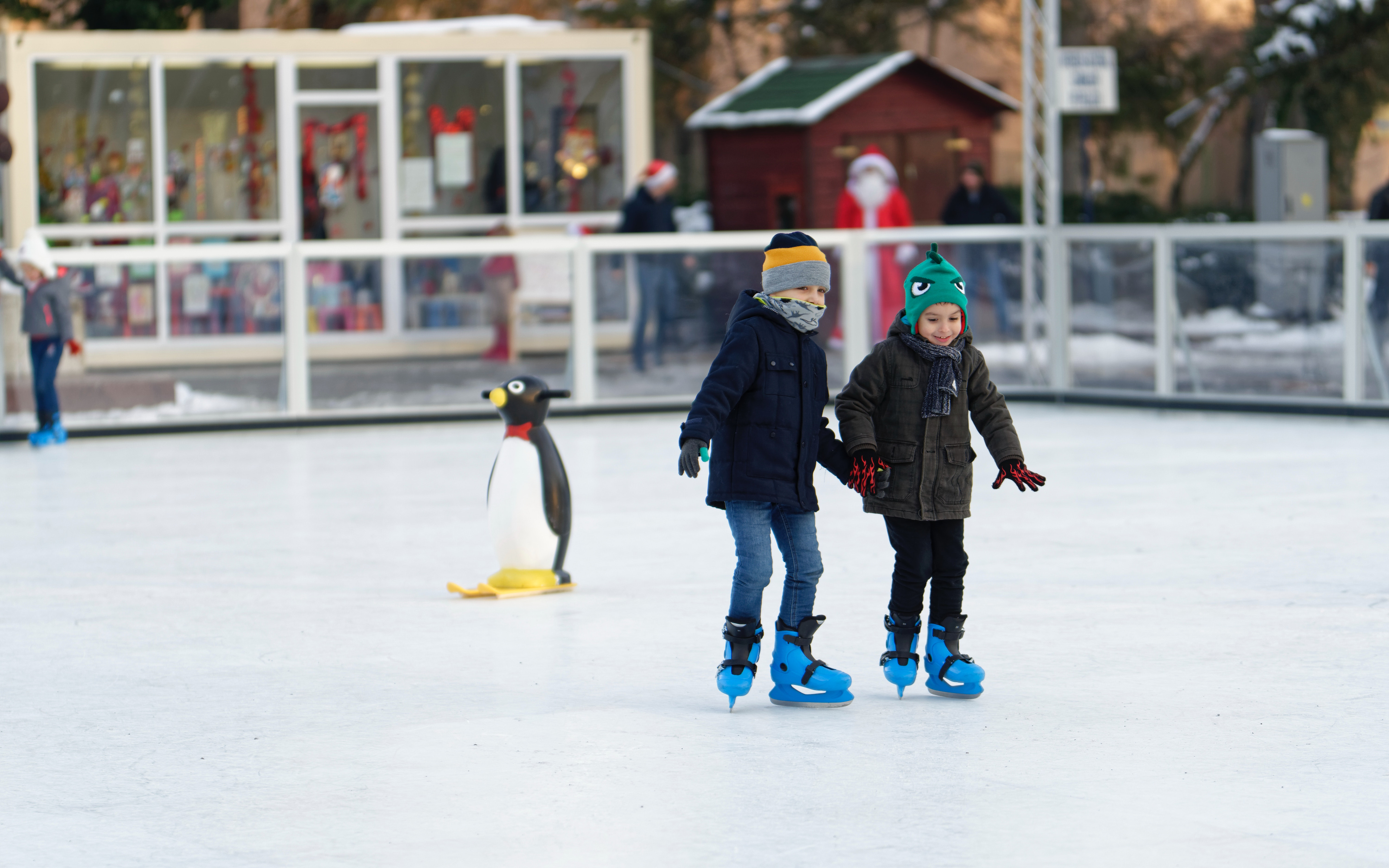two-children-inside-of-ice-skating-field-1722444